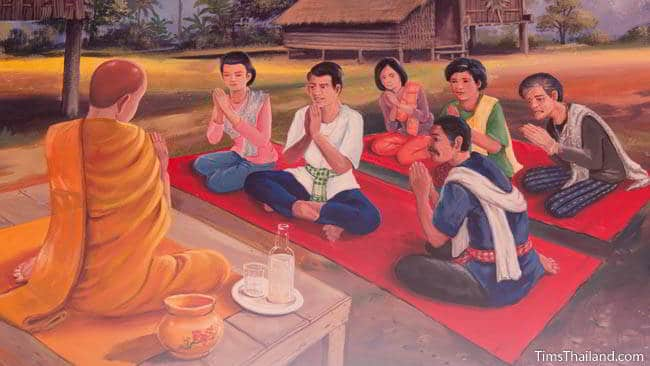 Buddhist temple mural painting of people sitting in front of a monk.