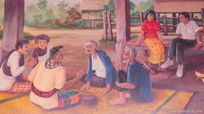 Buddhist temple mural painting of people sitting and chatting.