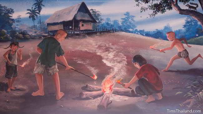 Buddhist temple mural painting of children playing with fire.