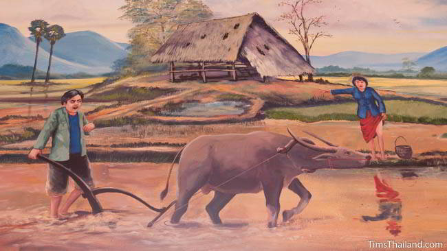 Buddhist temple mural painting of working in a rice field.