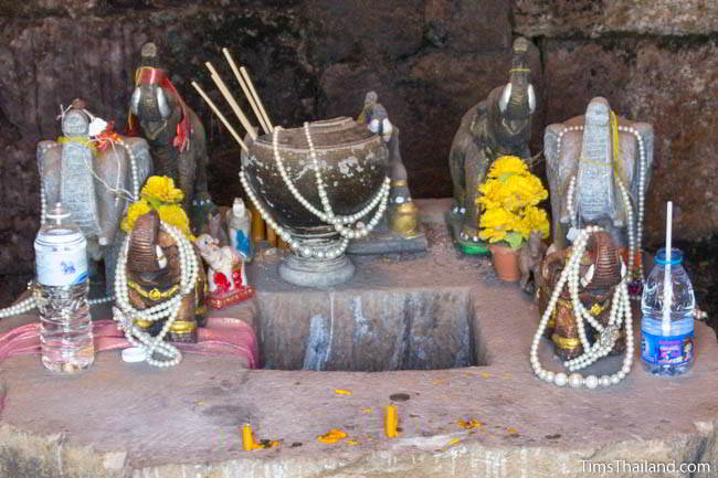 Shrine with ancient Khmer pot in Ban Phluang Khmer ruin in Thailand.