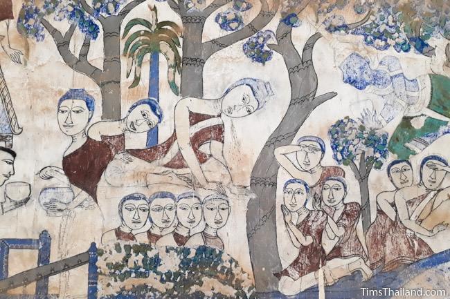 close up of buddha vomiting on mural painting at wat yang tuang wararam