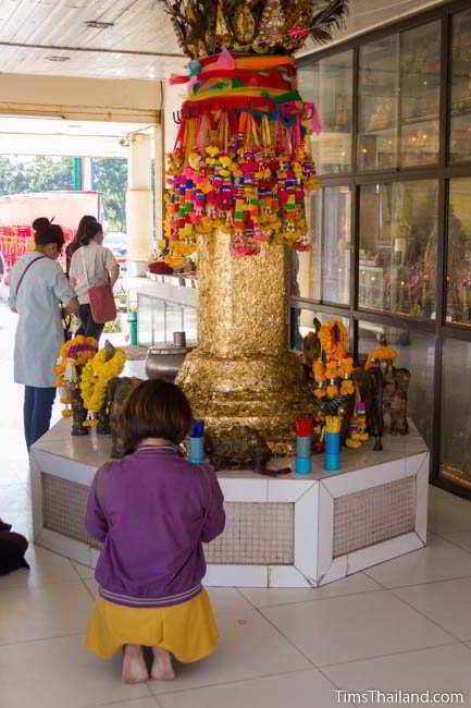 Replica city pillar covered in gold leaf at current Khon Kaen city pillar shrine