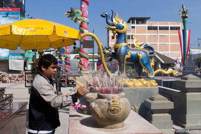 Making an offering in front of a kochasi at current Khon Kaen city pillar shrine