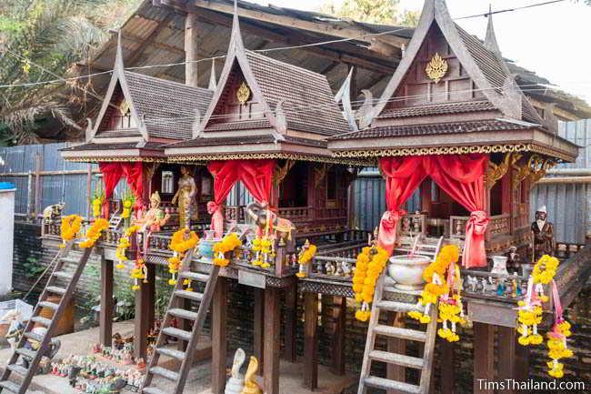 Old spirit houses behind Khon Kaen's Khmer-style Mahesak Shrine