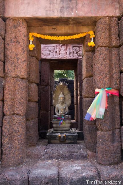 Buddha and replica lintel in Ku Ban Daeng Khmer ruin central tower