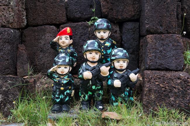 soldier statues in front of Ku Buamat Khmer ruin