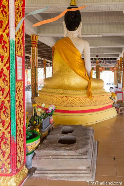 sandstone pedestal of Ku Bueng Jiew Khmer ruin next to buddha statue