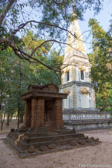 shrine made form laterite of Ku Mithila Khmer ruin with stupa in back