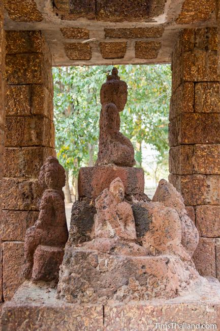 laterite carving, perhaps of Phra Malai, in shrine of Ku Mithila Khmer ruin