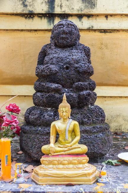 laterite carving of Phra Sangkajai at Ku Mithila Khmer ruin