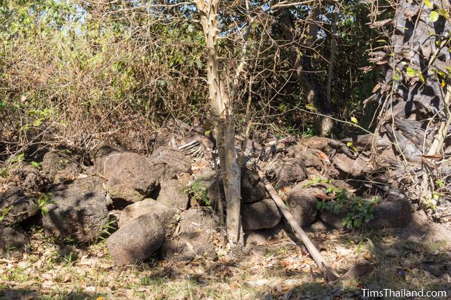 pile of blocks behind Ku Phanna Khmer ruin