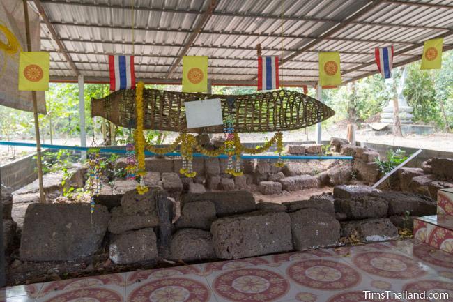 Ku Sampan Ka Khmer ruin with good luck fish trap hanging in front