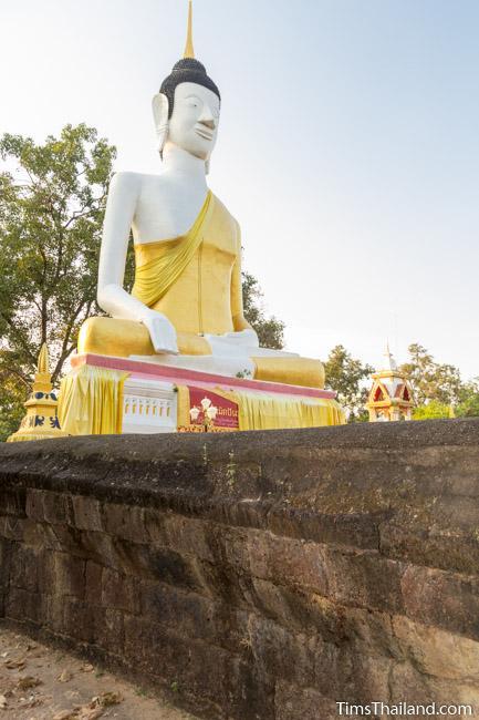 Large Buddha surrounded by laterite enclosure at Ku Sunthararam Khmer Ruin