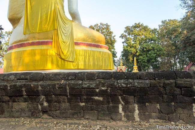 Back of large Buddha surrounded by laterite enclosure at Ku Sunthararam Khmer Ruin