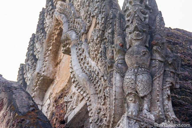 stucco garuda and naga at prang wat chulamani khmer ruin
