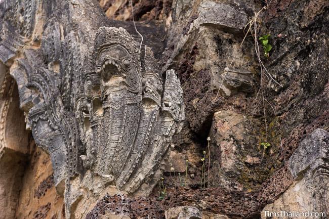 stucco naga at prang wat chulamani khmer ruin