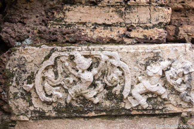 stucco human and garuda at prang wat chulamani khmer ruin