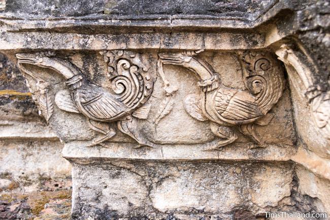 stucco swans at prang wat chulamani khmer ruin