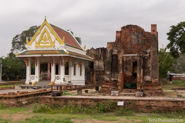 new and old building at prang wat chulamani khmer ruin