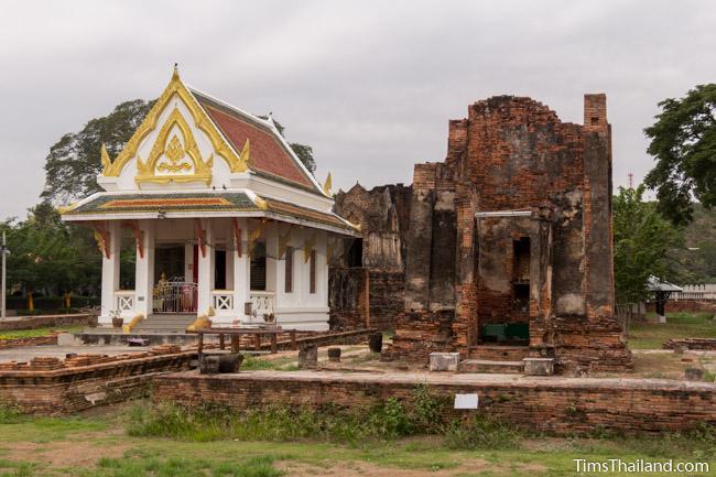 new and old building at prang wat chulamani khmer ruin