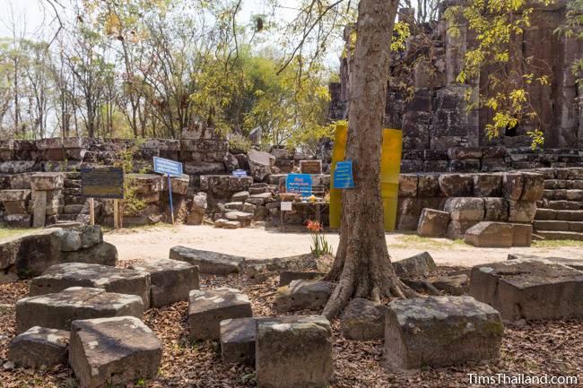 signs next to Phra That Phu Phek Khmer ruin