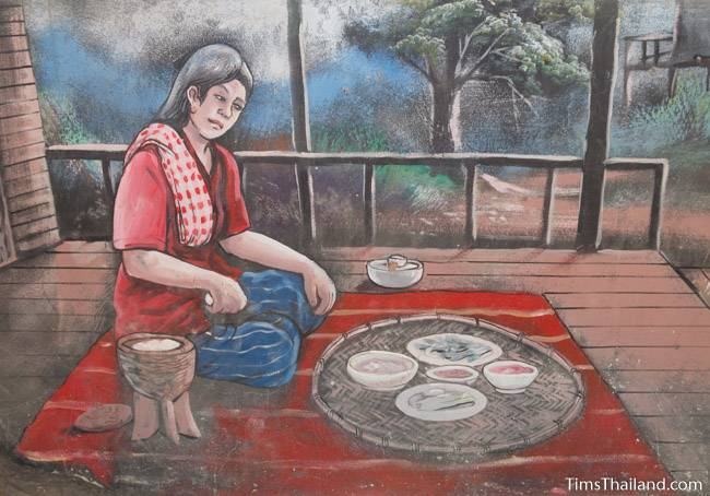 picture of woman eating on Wat Pho Nontan meditation hall