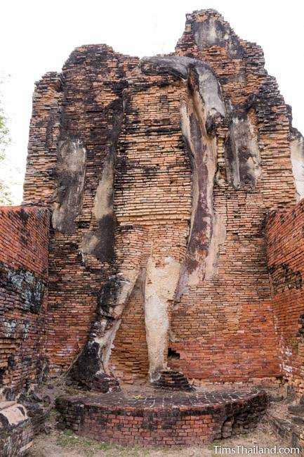 walking Buddha in mondop at Wat Phra Phai Luang Khmer ruin