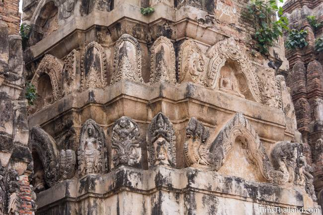 stucco on tower of Wat Si Sawai Khmer ruin