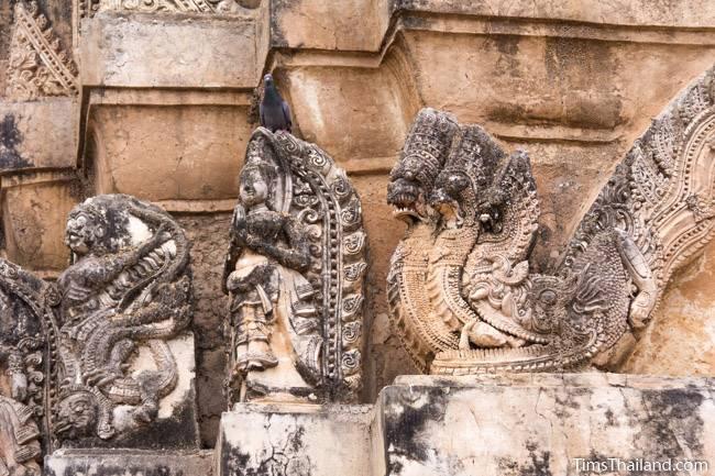 stucco on tower of Wat Si Sawai Khmer ruin
