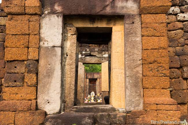 looking through the gopura of Prang Ku Ban Nong Faek Khmer ruin