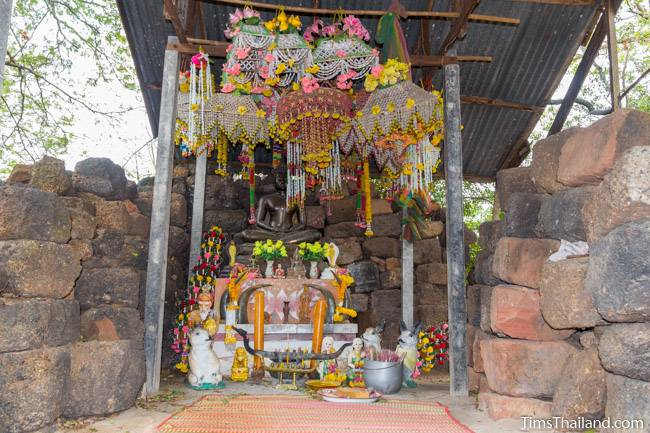 Buddha image inside Prang Ku Kaeng Sanam Nang Khmer ruin
