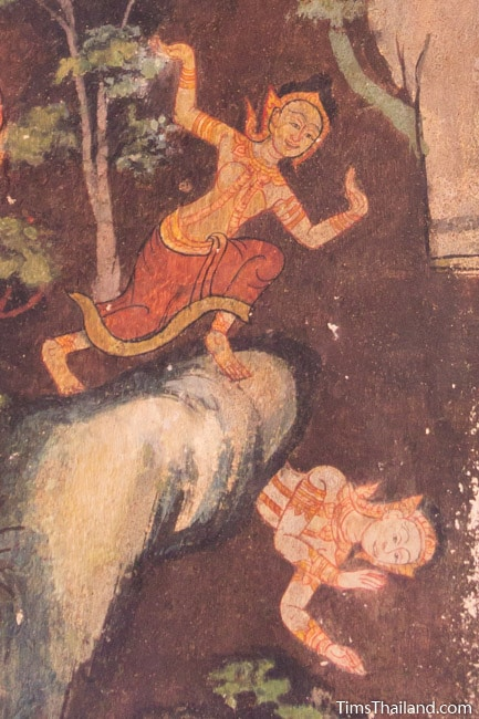 mural painting of Bodhisatta's wife pushing him off the cliff from the Culla-Paduma Jataka in ubosot of Wat Thung Si Muang