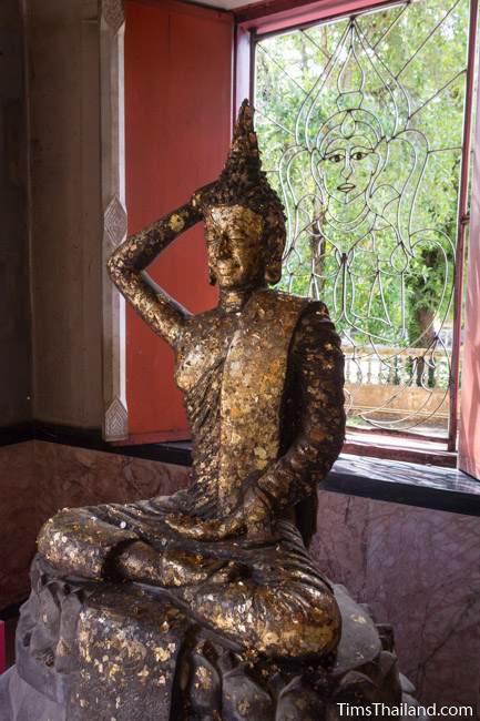 Buddha touching his hair posture