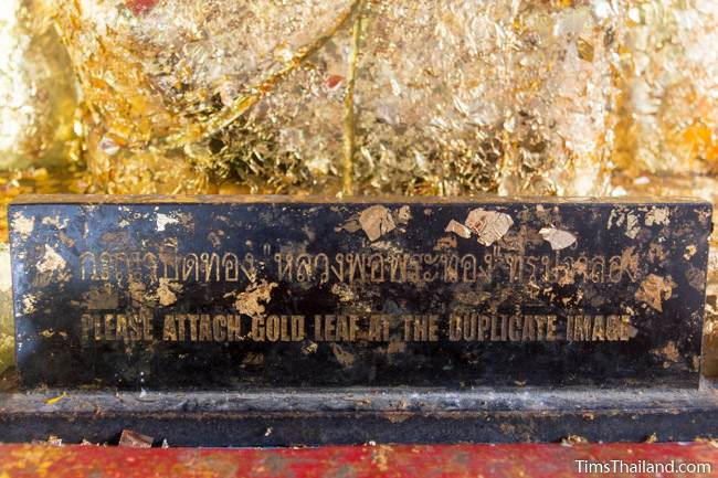 sign below buddha saying gold leaf can be used