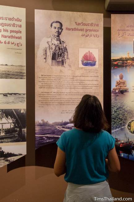 woman looking at historical panel in Narathiwat City Museum