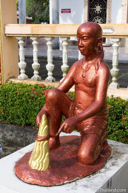 statue of boy from Luang Por Phra Phut Buddha image legend