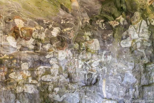 wall of paintings at Tham Sam cave