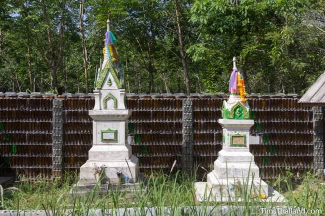 Wat Khuat bottle temple's bottle wall and funerary stupas