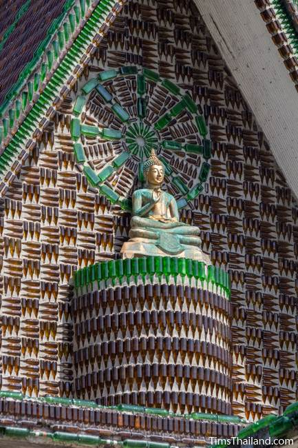 Buddha and dharma wheel at Wat Khuat bottle temple