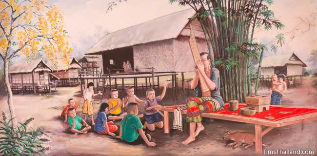 mural of man playing kaen to group of children