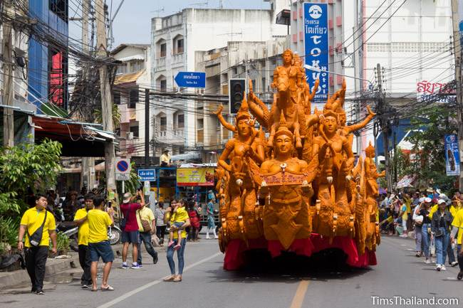 Khao Phansa candle parade float driving down the street