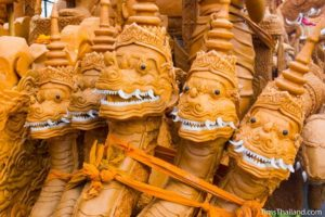 naga heads on a Khao Phansa candle parade float