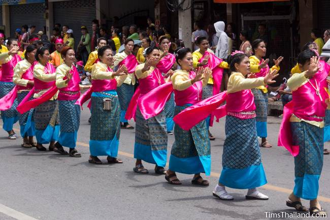dancers wearing traditional Thai dresses in Khao Phansa candle parade