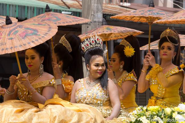 women with umbrellas in a Khao Phansa candle parade