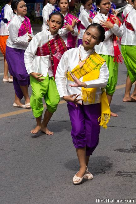 young women dancing in a Khao Phansa candle parade