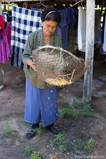 woman winnowing puffed rice