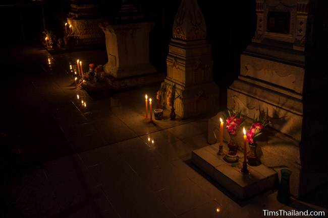candles in front of funerary stupas during Ok Phansa