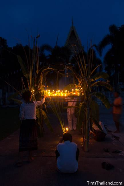 lighting candles during Ok Phansa
