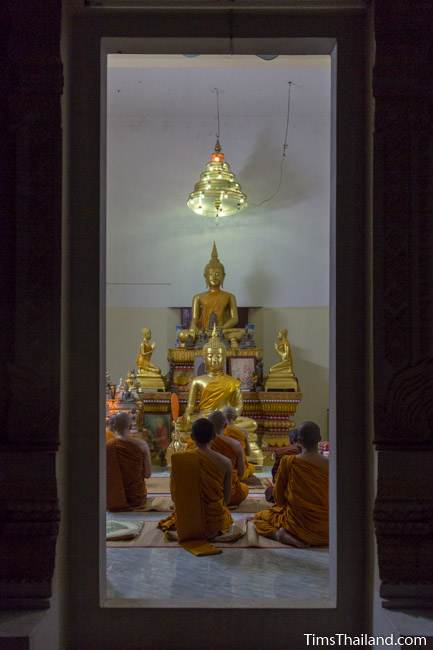 monks meditating in the ubosot during Ok Phansa